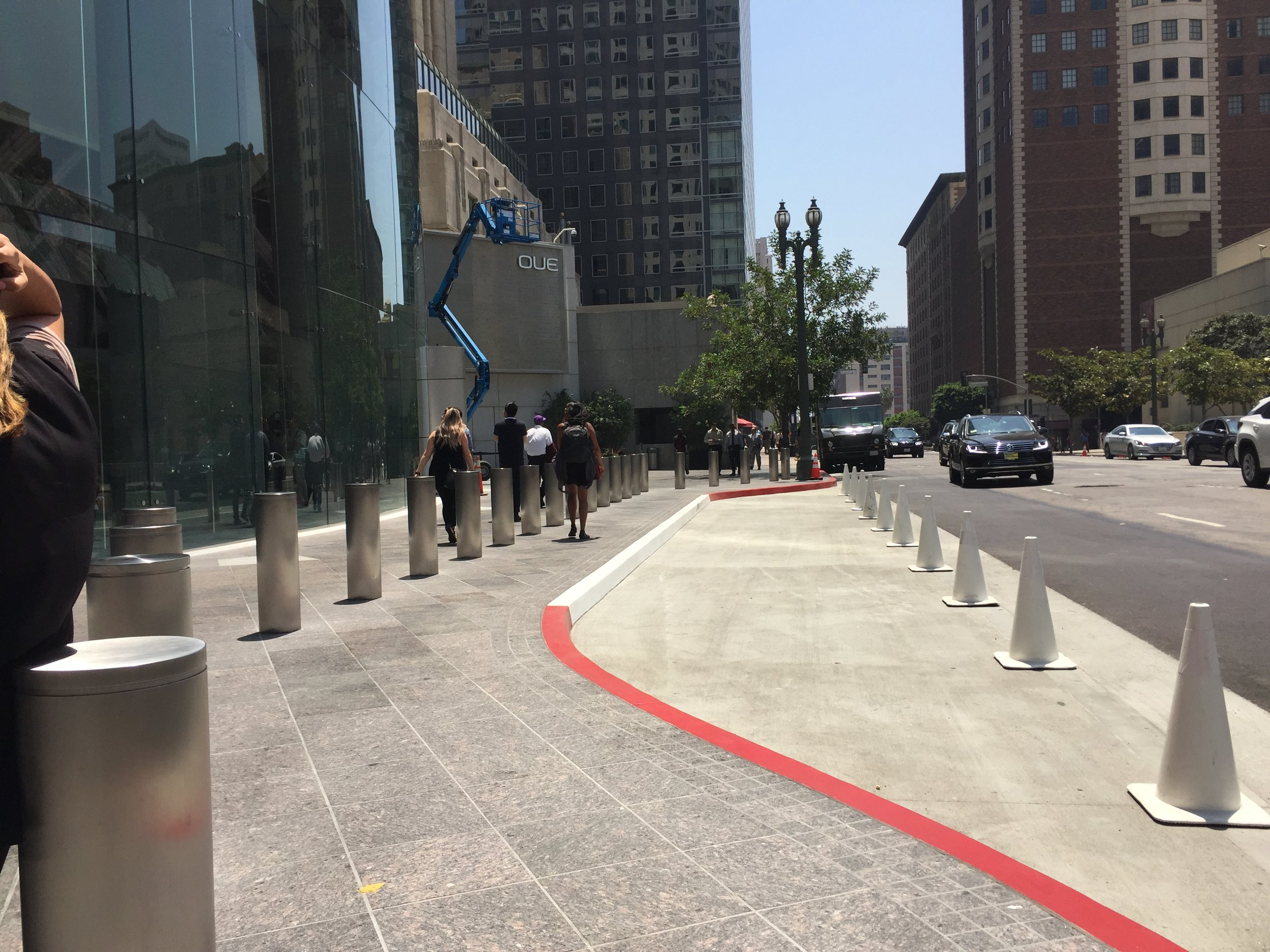 The new car passenger loading lane that took an enormous chunk out of the sidewalk in front of the U.S. Bank Tower in downtown Los Angeles, July 2016.