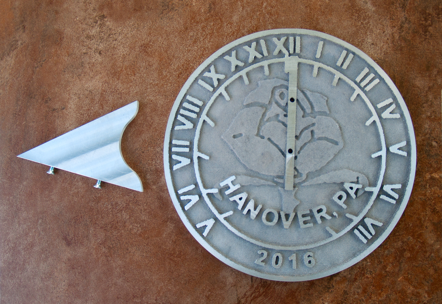 Completed sundial and gnomon.