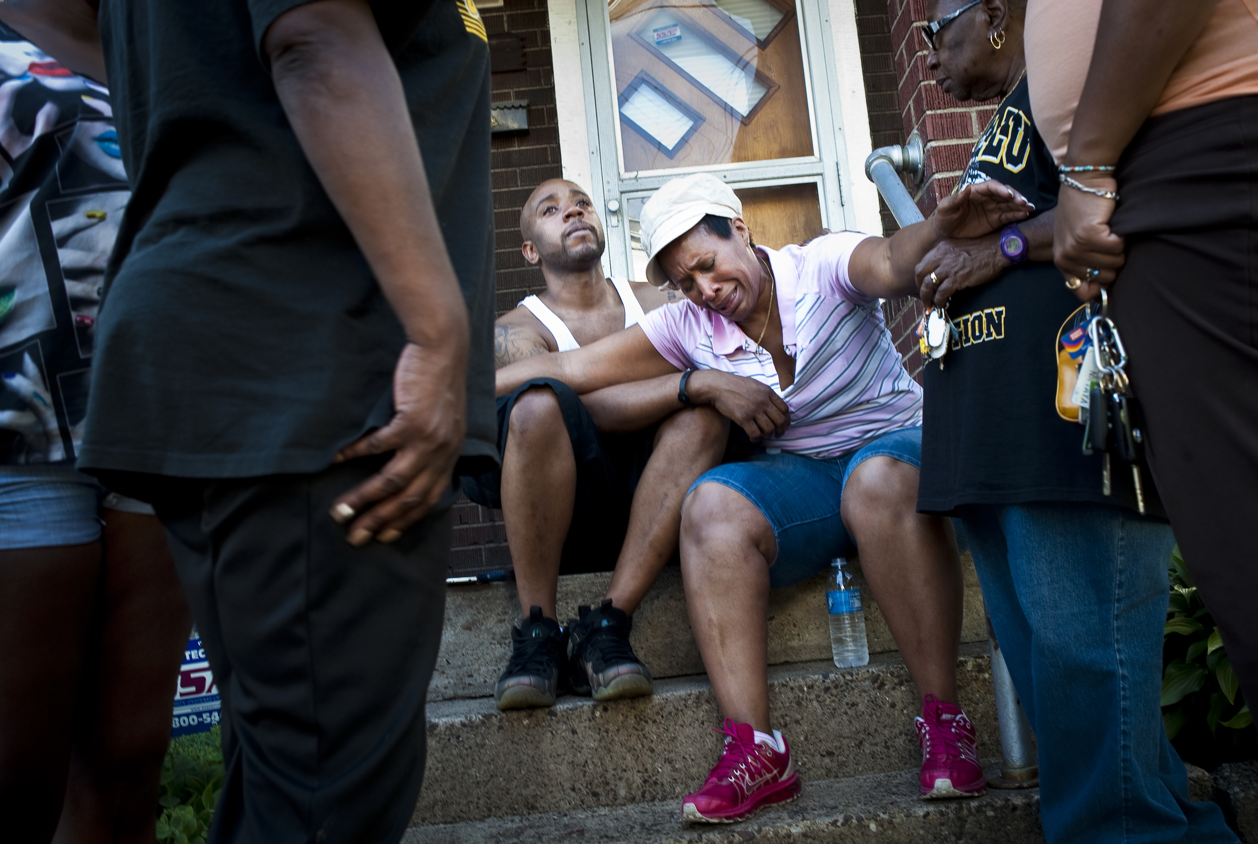 Dominic Reaves comforts his mother Alicia Reaves as she cries at the sight of her home in flames on North Holland Avenue in Rankin that caught fire Saturday evening, July 5, 2014