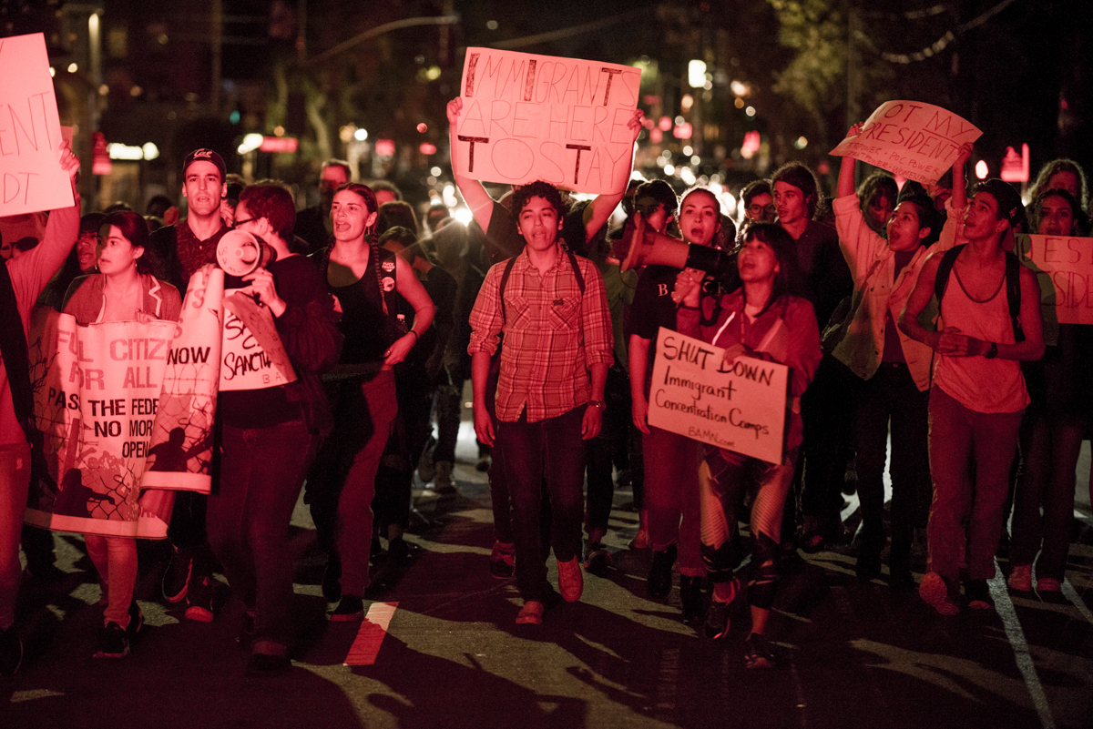 "UC Berkeley students march through downtown Berkeley in protest of President-elect Donald Trump on November 10, 2016. Chants of ""Immigrants are here to stay!"" reflected the groups demands to defend sanctuary cities and campuses and shut down immigrant detention centers in the United States."