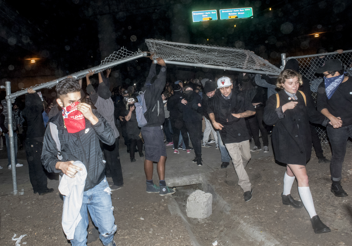 President-elect Donald Trump protesters broke through freeway fencing and attempted to take Interstate 580, but were stopped by riot police in downtown Oakland on November 10, 2016.