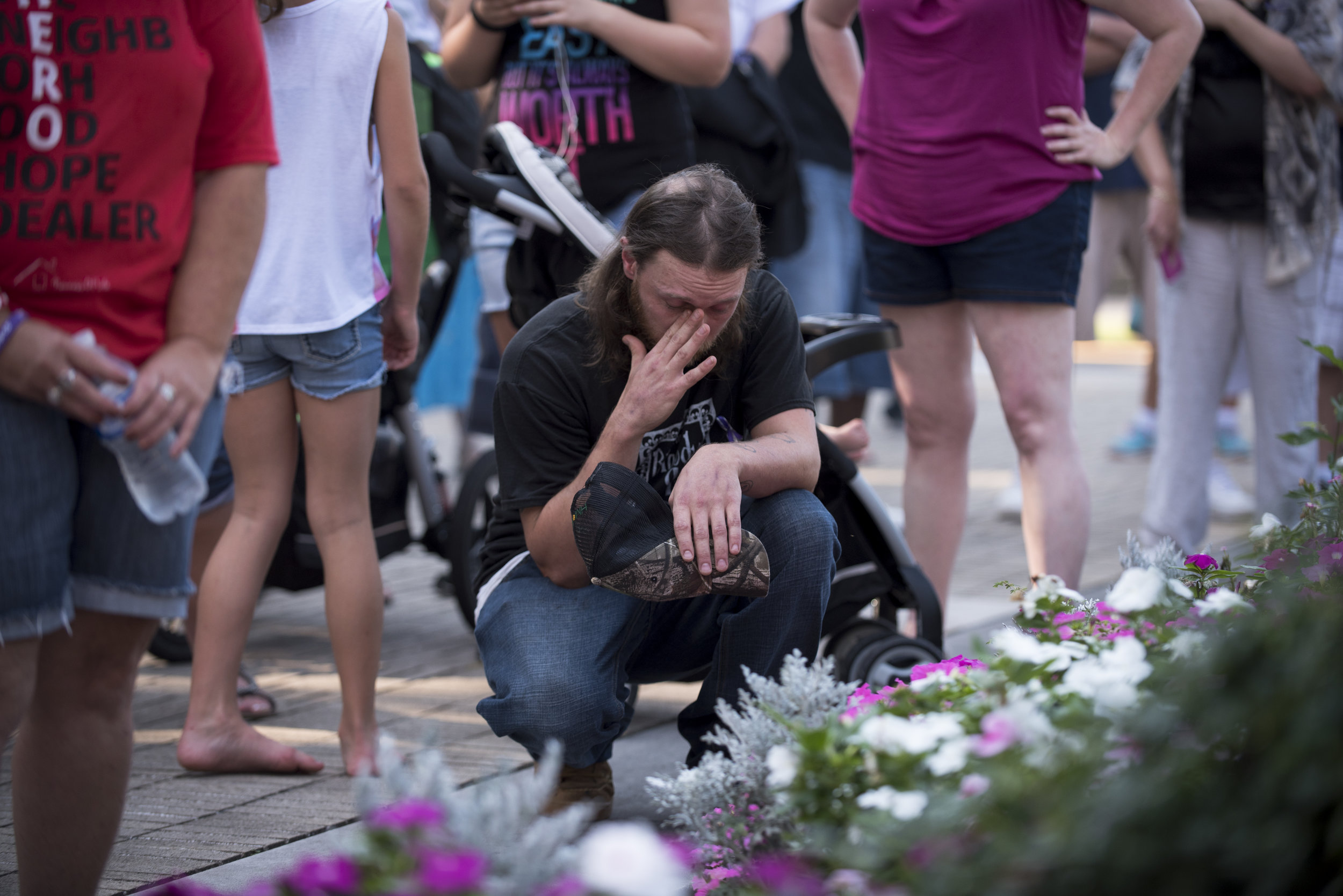 Ryan Fieldman, 33, kneels during the opening prayer at the West Virginia Overdose Awareness Day Tribute at the State Capitol in Charleston, WV on August 27, 2016. Ryan is currently in recovery at Jacob's Ladder in Aurora, WV.