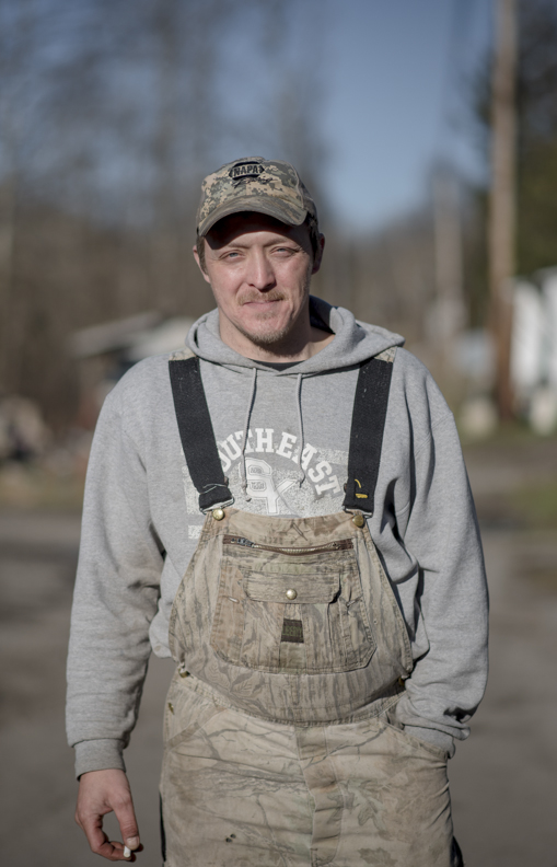 Coy Riley, who was laid off from his coal mining job, outside of his home in Jenkins, KY.