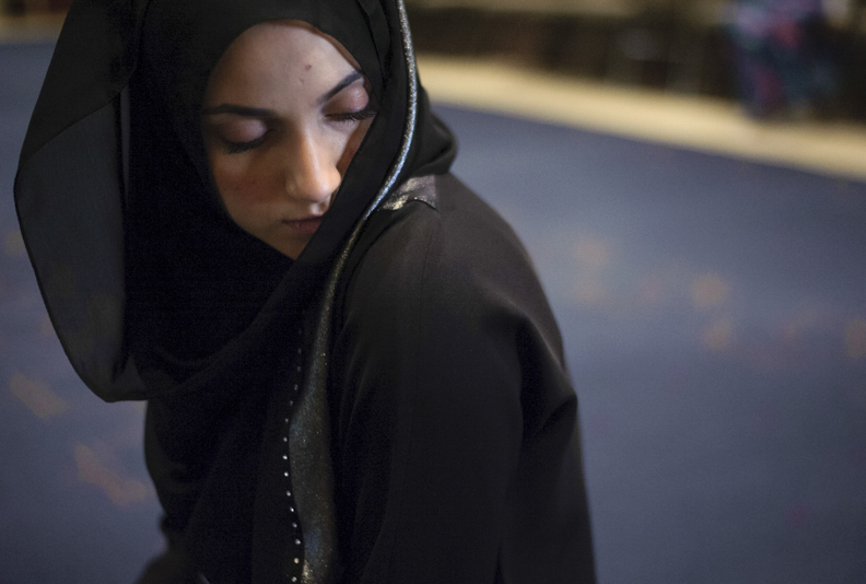 Mariam Aboukar, 25, of Dublin, Ohio, finishes her afternoon Dhuhr prayer by looking to the left at the Noor Islamic Cultural Center in Dublin, Ohio on December 1, 2013.