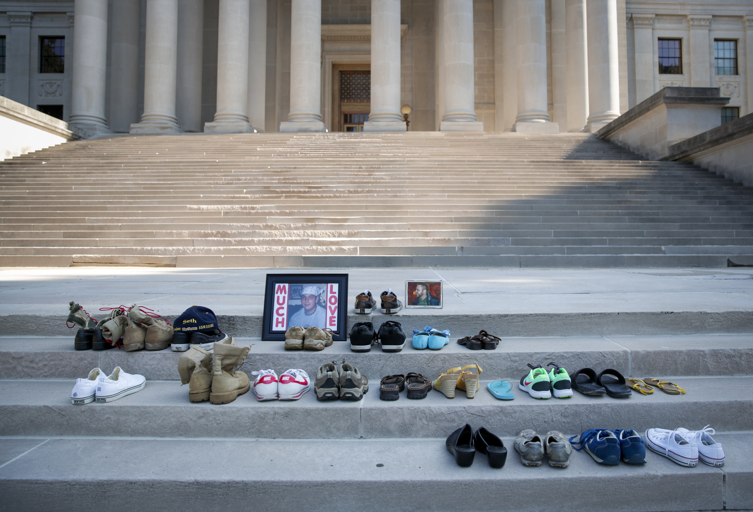 Shoes of family and friends who died from heroin overdoses rest upon the steps of the State Capitol in Charleston, WV at the start of the West Virginia Overdose Awareness Day Tribute on August 27, 2016.