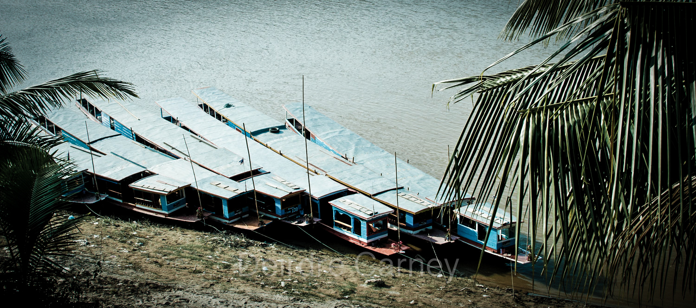 Slow boats docked on the Mekong at Luang Prabang
