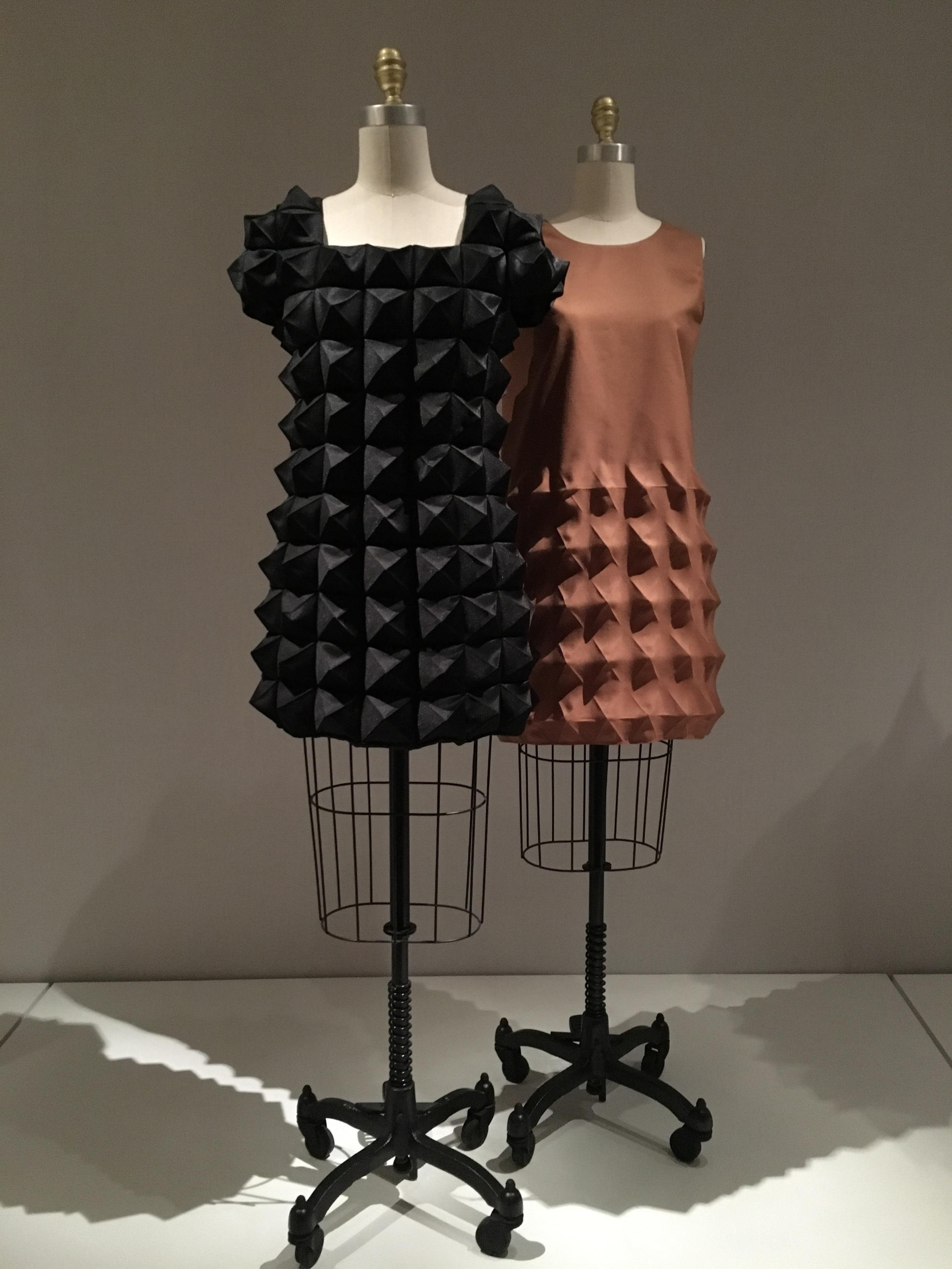 Comme des Garçons  Junya Watanabe  AW 2015/2016, prêt-à-porter  Machine sewn, heat-molded black polyester satin    Pierre Cardin  1968, haute couture  Machine sewn, heat-molded brown polyester Cardine (Dynel)