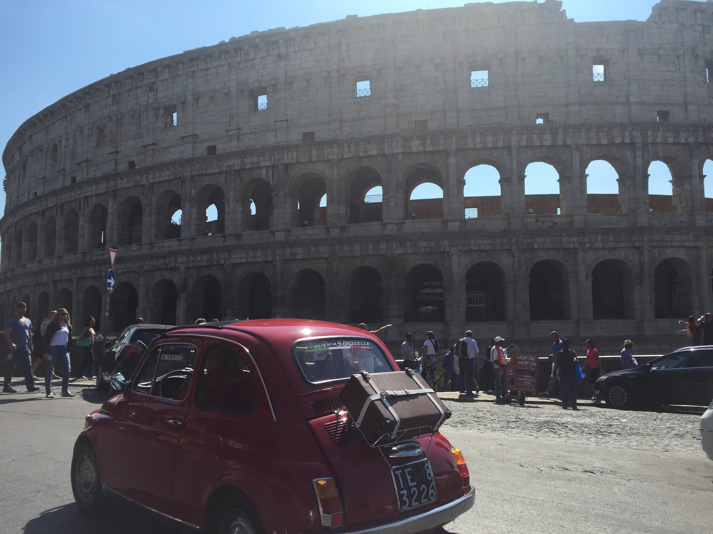 A perfectly restored Fiat cinquecento (500) driving alongside of us in Rome.