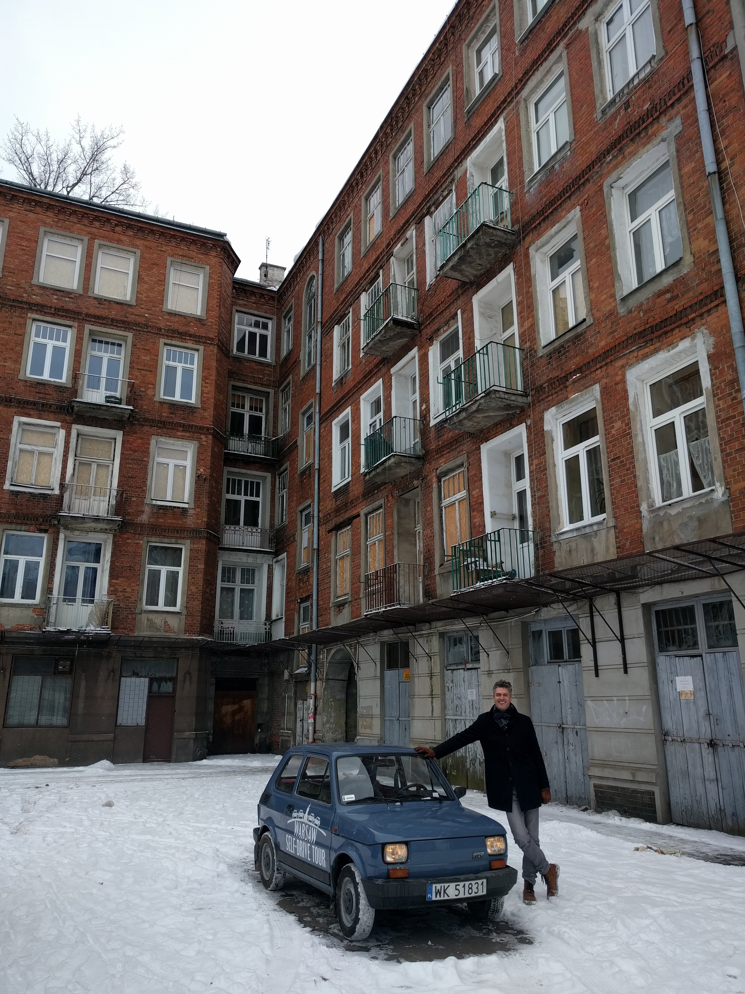 Stopped in the courtyard of a pre-communist ear building in Warsaw's Praga District.