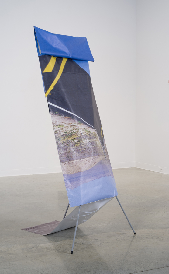 New Phase , 2014; banner stand, vinyl, thread, metal, plastic; 71 x 33 x 33""