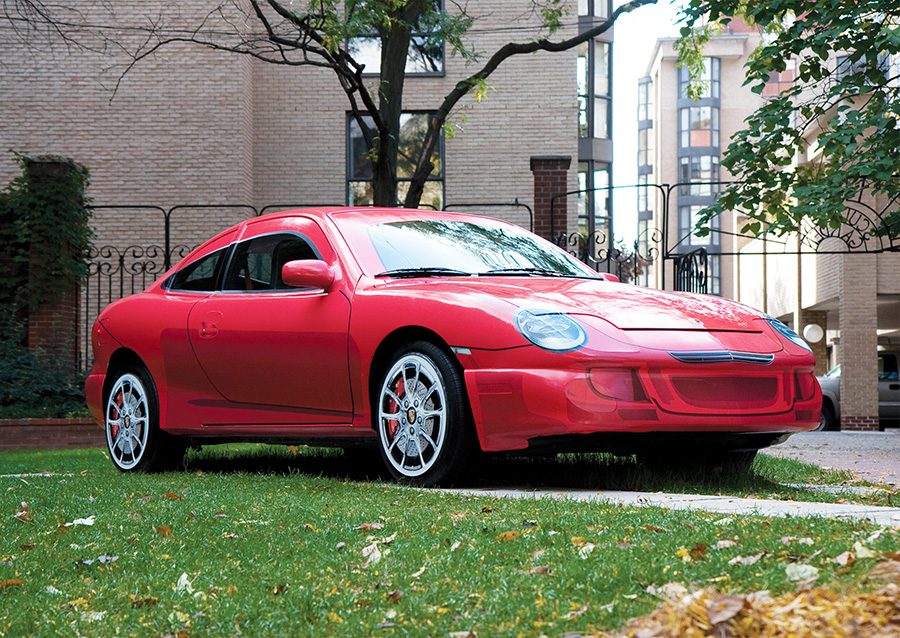 UPGRADE , 2007; 1998 Pontiac Sunfire, printed adhesive sign vinyl, plexiglas, styrofroam, concrete, metal; 450 x 171 x 130 cm; commissioned by the Toronto Sculpture Garden; a used vehicle is re-surfaced to make it look like a current model of the Porsche 911