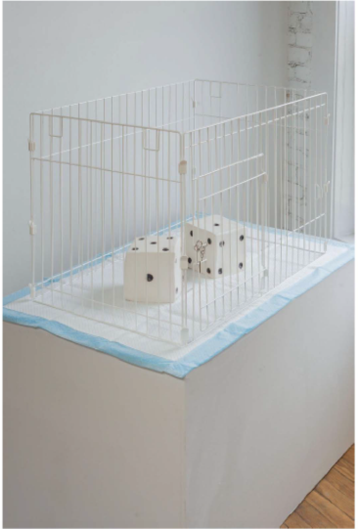 "No Dice, 2017 Porcelain, dog cage, wee wee pad 27.5 x 44 x 18"" (69.9 x 111.8 x 45.72 cm)"
