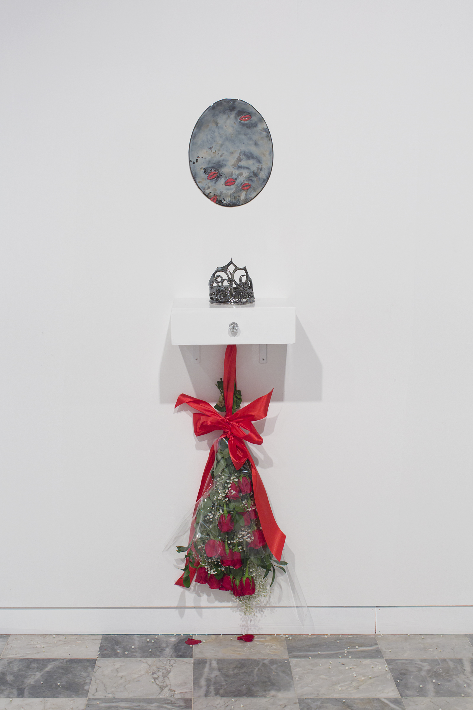 "Deborah Carthy-Deu, Miss Universe 1985, 2018  Porcelain mirror, porcelain crown, vanity, red roses, silk, cellophane, baby's breath, hardware Porcelain mirror 14 x 8"" (35.6 x 20.3 cm), vanity shelf 12 x 15 x 4.5"" (30.5 x 38 x 11.4 cm)   Overall dimensions variable"