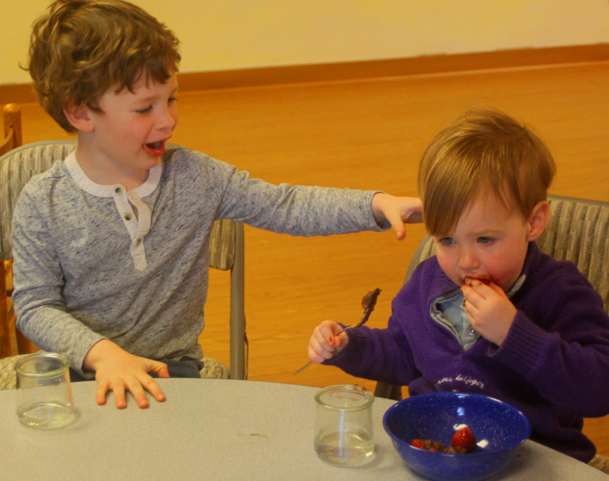 Lochlan and Sylvie eating birthday snack email.jpg