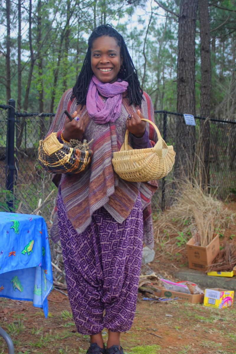 Nina with baskets of fairy house materials email.jpg