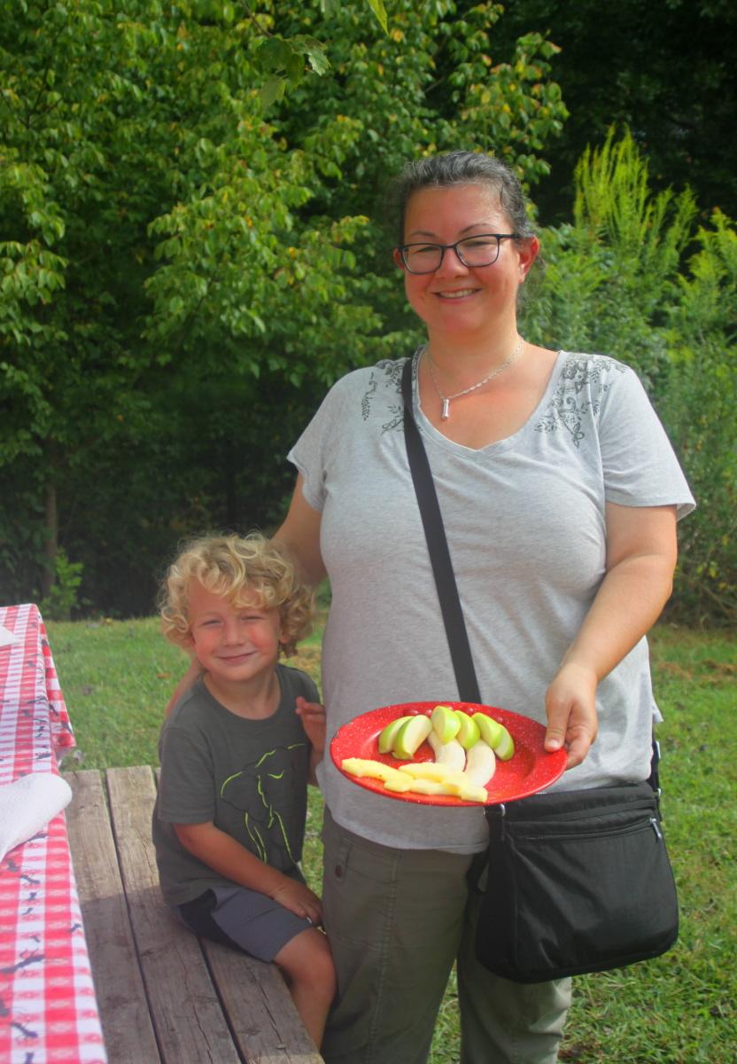 Ki Debbie helps prepare our island snack email.jpg