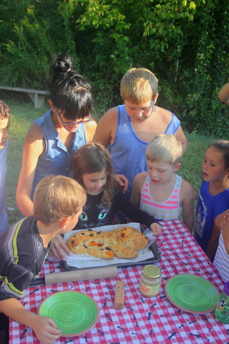 Ki Kelly & Logan create a bread dragon for the HomeSchool group email.jpg