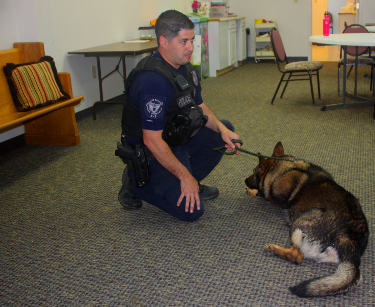 Officer Elijah explains the work his dog does email.jpg