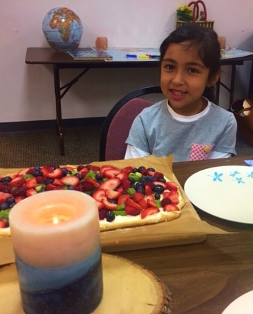 Birthday girl with fruit pizza.jpg