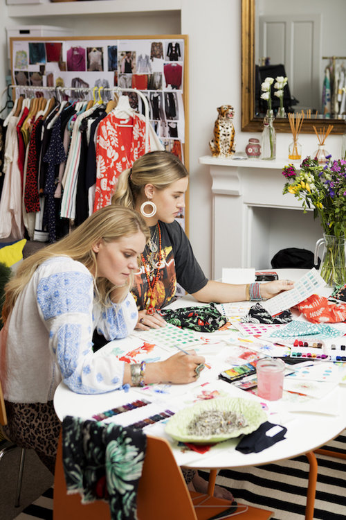 Henrietta and Orlagh hand-painting dress designs in their studio in London
