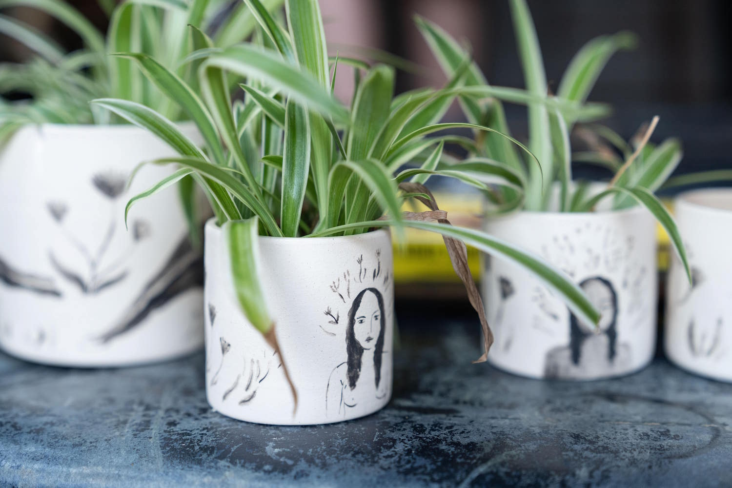 Julianna's own hand-painted ceramics filled with ferns and grasses - perfectly embodying her artistic style.