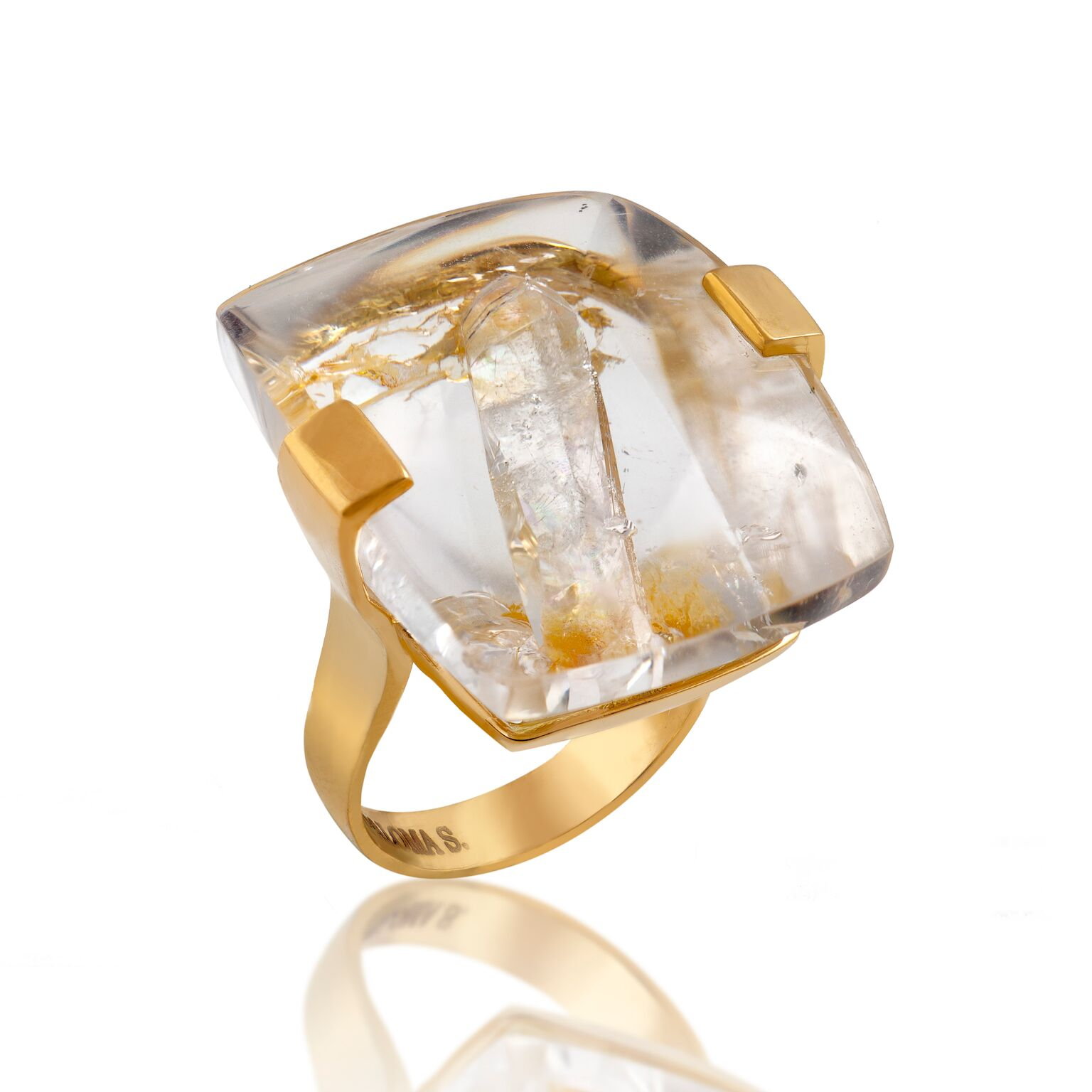 An unusual crystal-embedded-in-a-crystal with rutile needles set in 18k yellow gold ring