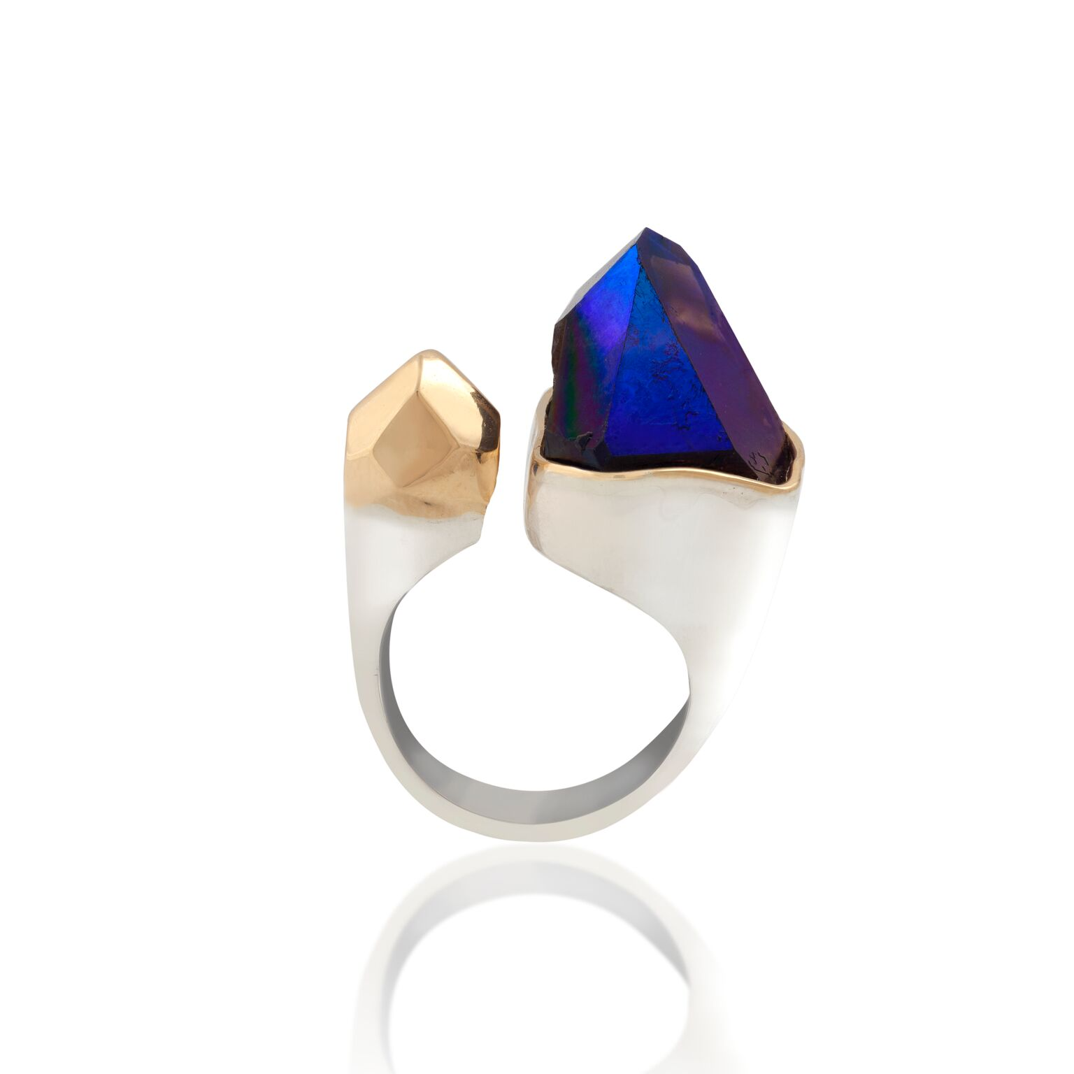 A sliced tip of a crystal, infused with titanium, with an 18k gold bezeland a 18k solid gold nugget, set in white gold-plated silver ring