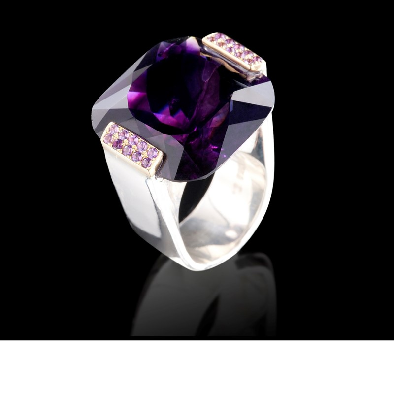 A deep purple amethyst from Madagascar is gripped by amethyst pavé set in 18K gold. Ring is set in 925 silver
