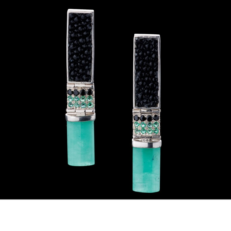Modern earrings with bars of Colombian rough emerald and black stingray leather, and hinged by emerald and sapphires. Set in 925 silver
