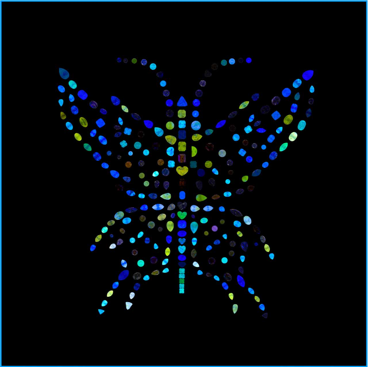 A Butterfly Art Piece Made of Different Natural Color Diamonds Under a UV Light.