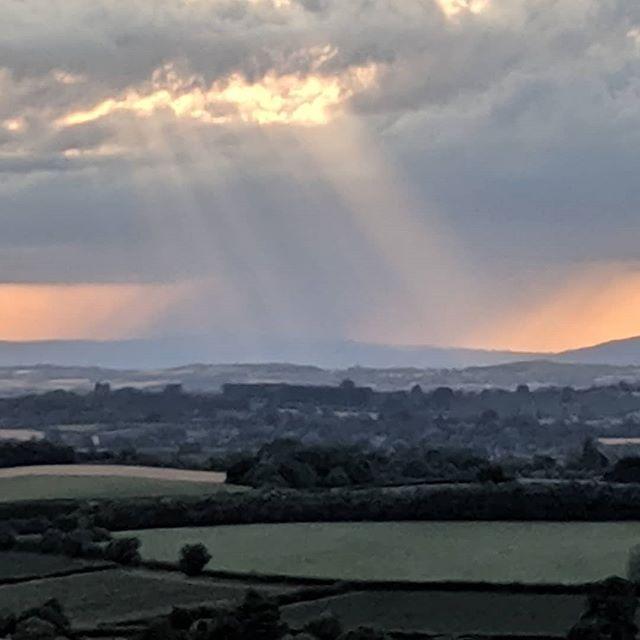 Sunlight and rain. England, earlier.  #landscape #landscapephotography #nofilter #sunlight #rain #somerset #fields