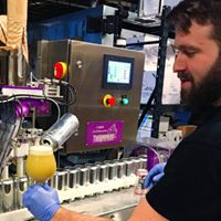 Brendan works the canning line at Stickman.