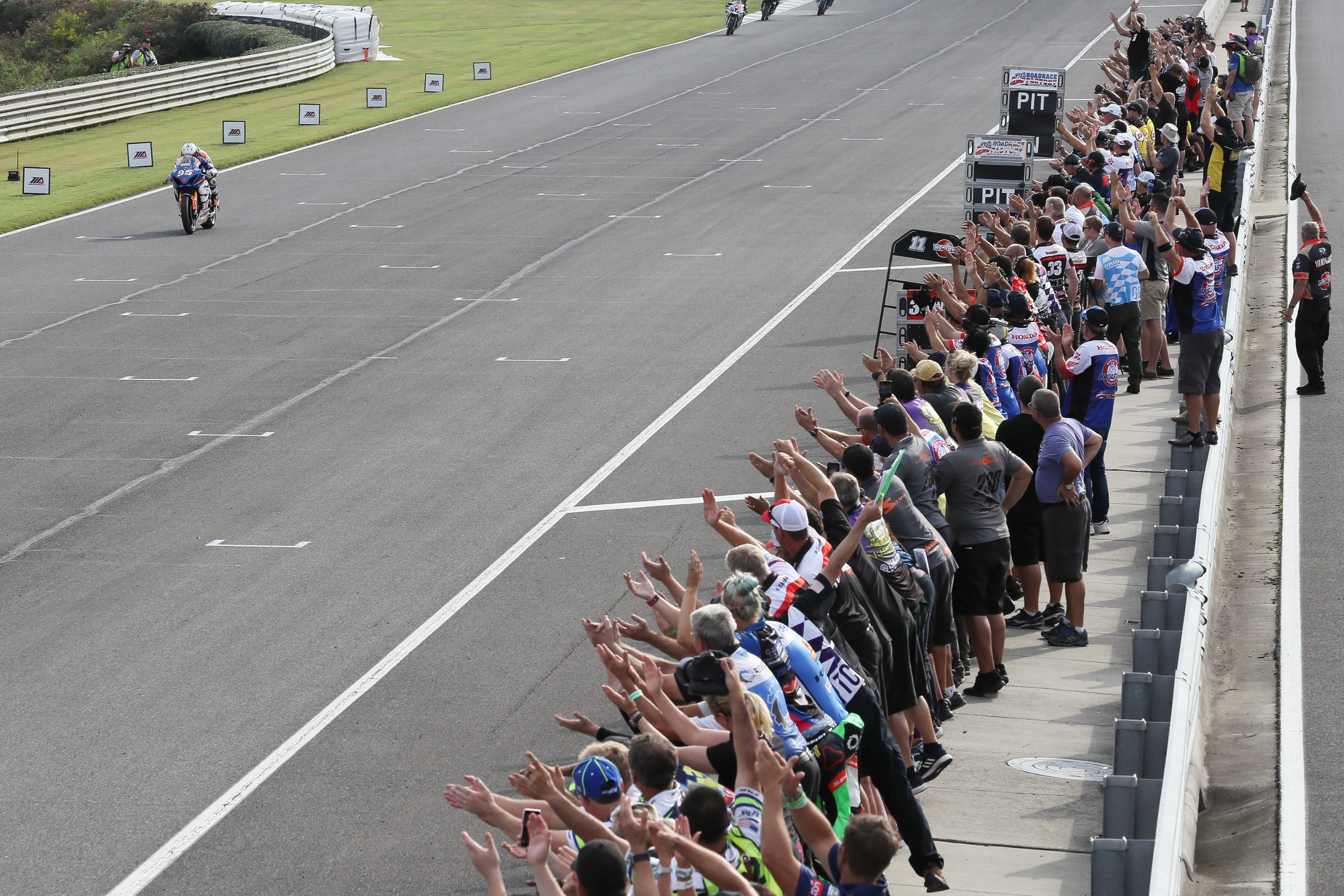 MotoAmerica race team members lined pit wall to cheer Yoshimura Suzuki's Roger Hayden to the finish in his final race. Earlier this summer Hayden announced his retirement from racing after 20 years on the professional circuit. (Brian J. Nelson photo)