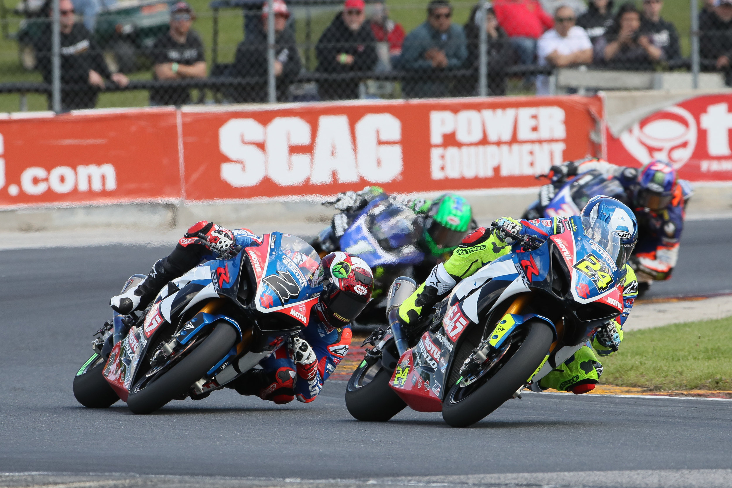 Yoshimura Suzuki Factory Racing's Toni Elias (No. 24) and Josh Herrin (No. 2) battled this close nearly the entire way on Saturday at Road America. Elias took the victory, his 28th in MotoAmerica Superbike, putting him in the top-five on the all-time wins list. (Brian J. Nelson photo)