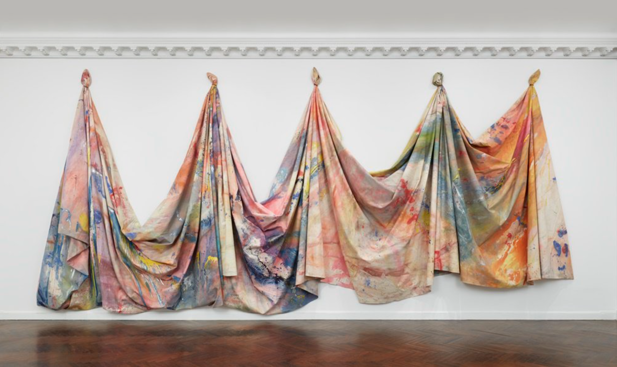 "Installation view of ""Sam Gilliam : 1967–1973 at Mnuchin Gallery. Photography Tom Powel Imaging. Artwork © Sam Gilliam. Image courtesy of Artnet News ( full article here )."