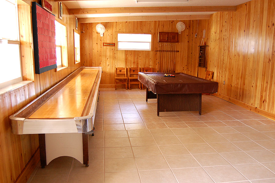 The recently renovated Game Room at Ridge Manor Campground holds a variety of activities for residents. You can play pool or indoor shuffleboard, watch TV, read the schedule of upcoming activities, sign a greeting card for a resident, use coupons for local businesses on the bulletin board or see photographs of your fellow neighbors.