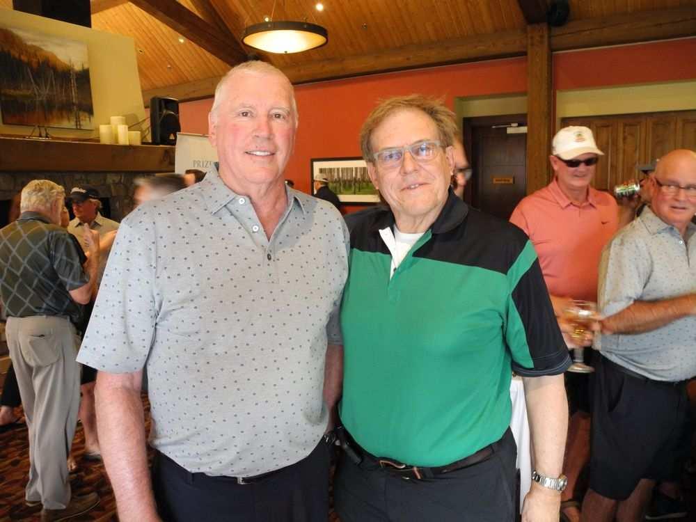 Remington Development's Randy Remington (left) with Riddell Kurczaba's Ron Kurczaba at the 11th Annual Remington Golf Classic. (Photo: Bill Brooks / Calgary Herald)