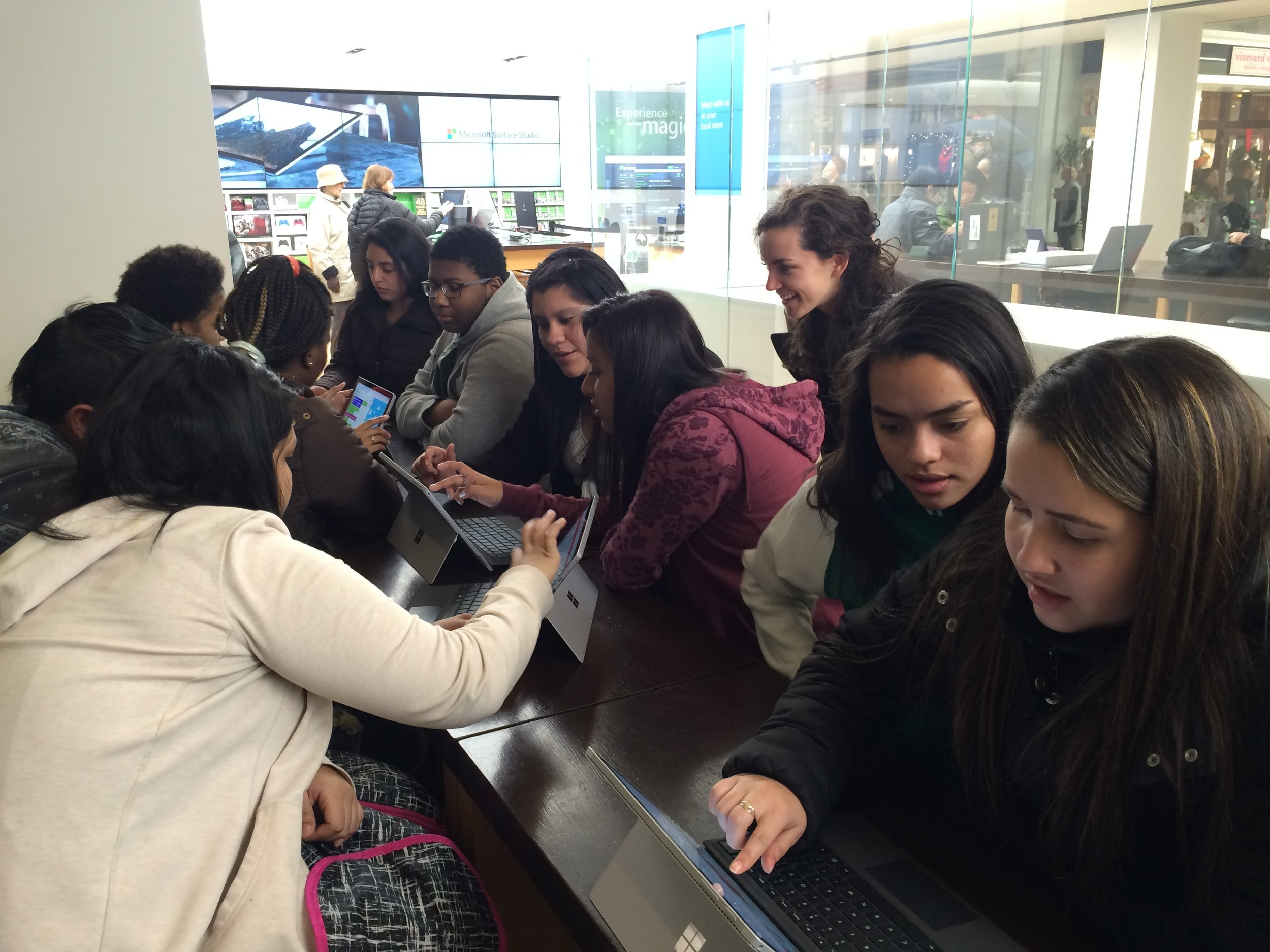 Emanuelle and other Somerville students try their hands at coding.