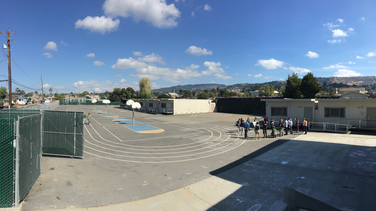 A planning session for the greening project on the paved schoolyard at Markham Elementary School. Photo © Green Schoolyards America