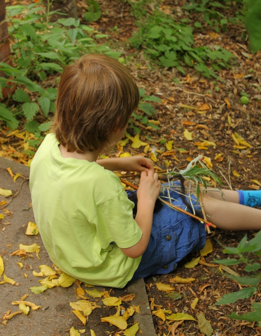 A student works on a nature-based art project at The Coombes School in England.