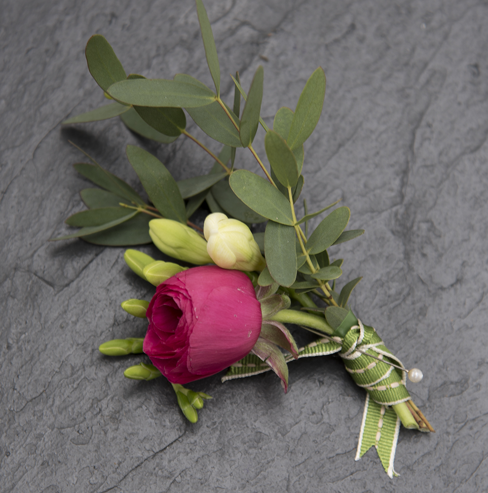 Deep pink rose buttonhole