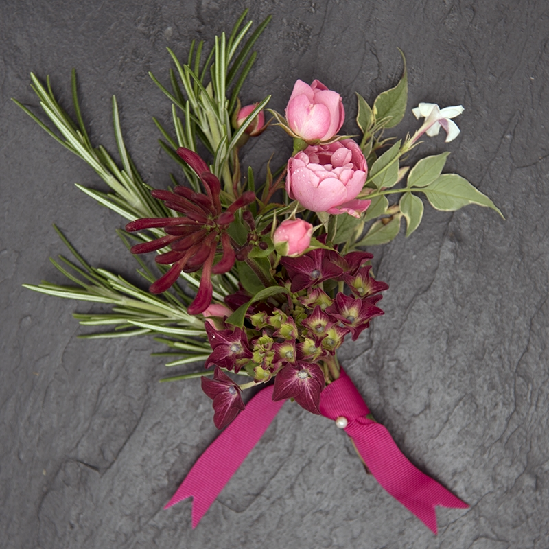 Pink and dark red buttonhole