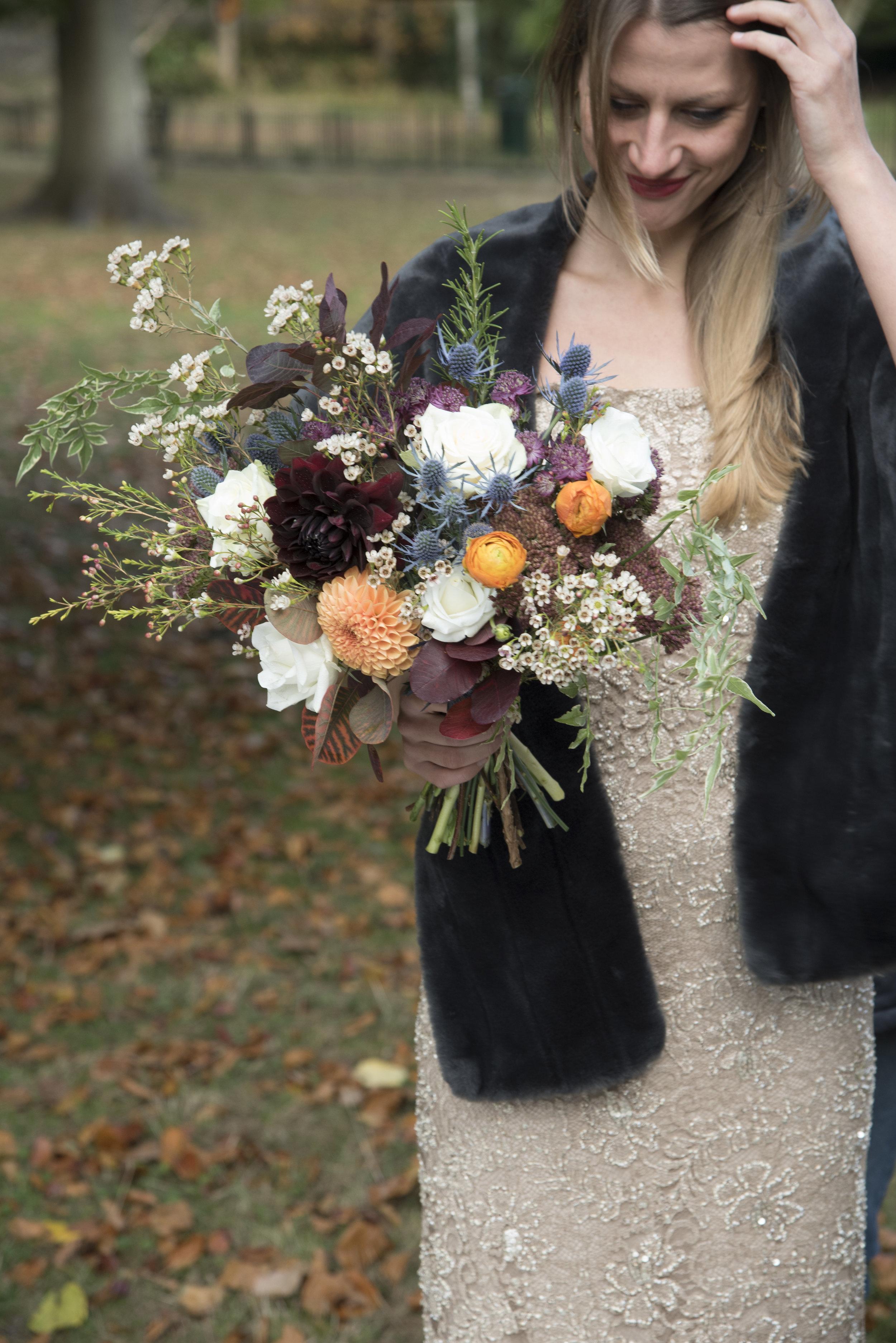 contrasting burnt orange and deepest chocolate dahlia for a seasonal wedding bouquet