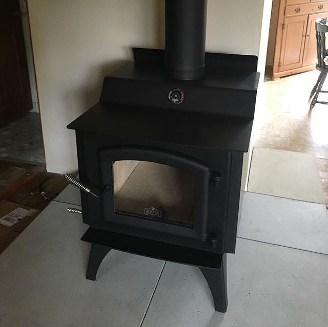 The Kuma Wood Classic is installed. Outside air is hooked up.  We'll fire it up tonight and start breaking it in. This project has been 5 years in the making. Feels great to know our house will be better warmed this winter and the air quality much improved over that old cast iron belcher we used to use. . . . #woodstove #warm #happy #owners #winteriscoming #wereready #maybe #craft #makersmovement #puremichigan