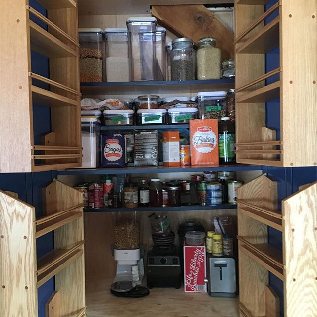 """After a few minor modifications, these pantry shelves are installed. My first try ended in turmoil, as the depth of the shelves caused them to smack each other when the doors opened. I notched the hinge side of the shelves to slide them over the euro hinges and thankfully, this was enough room for them to clear each other. I designed these shelves """"on-the-fly"""", with dimensions only, no drawings. It's a fun way to work, but obviously has its pitfalls.  In hindsight, a scale model would have been useful before moving on to the building phase. Sometimes though, don't you just want to wing it? . . . #furniture #design #shelves #kitchendesign #woodworkingtips #wooddesign #craft #woodcraft #oak #makersgonnamake #makersmovement #puremichigan #michigan #made #spice"""