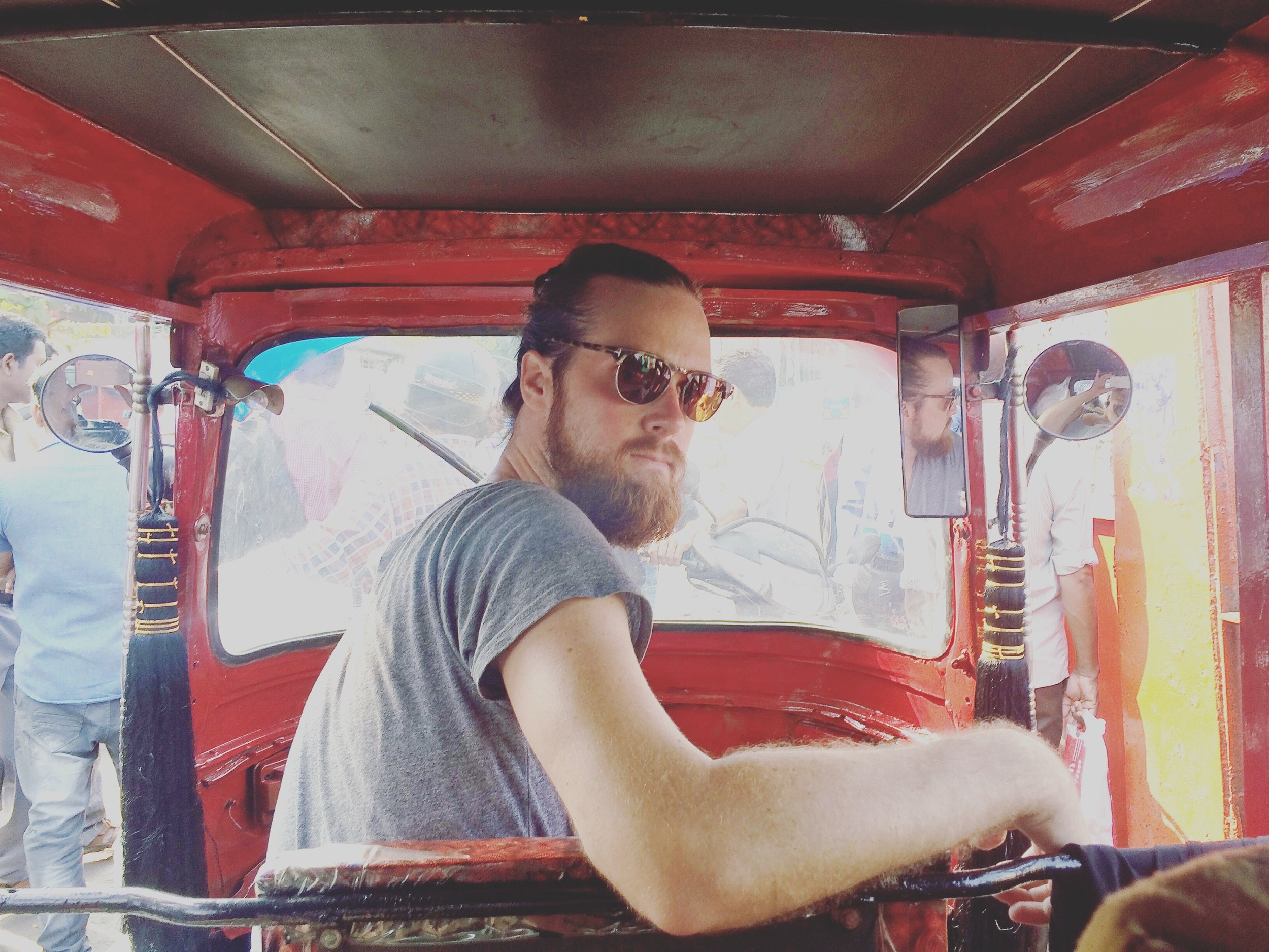 Nate in our rickshaw on a ferry