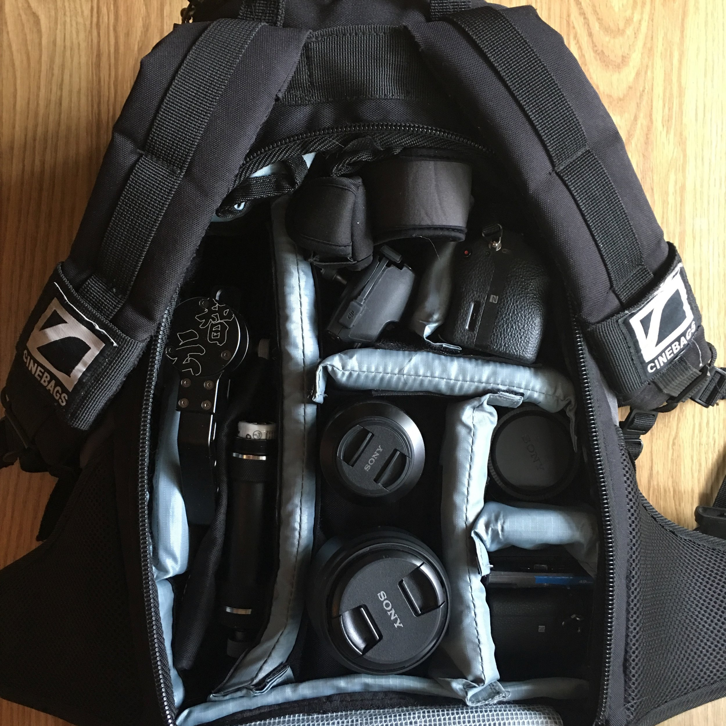 """The CineBags CB25B fits a lot of gear. Featured here: 2 Sony Alpha cameras, 3 lenses, Zhiyun Crane v2 gimbal, and DJI Mavic Pro drone, plus room for batteries, accessories and 15"""" MacBook Pro."""