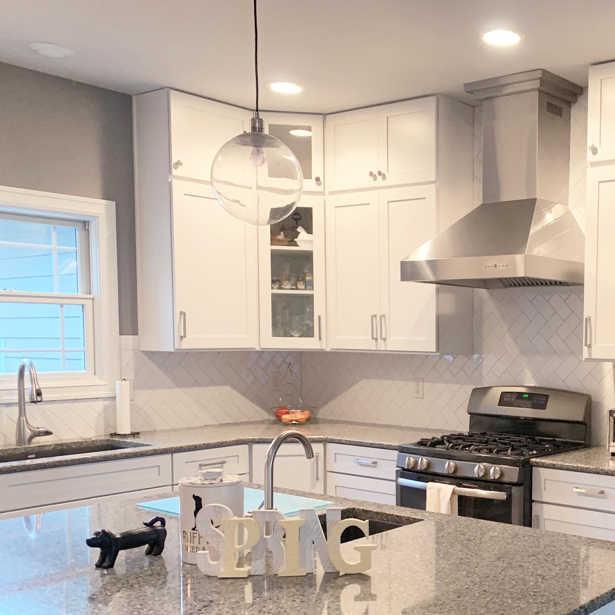 zline-stainless-steel-wall-mounted-range-hood-667-customer-kitchen-2 copy.jpg