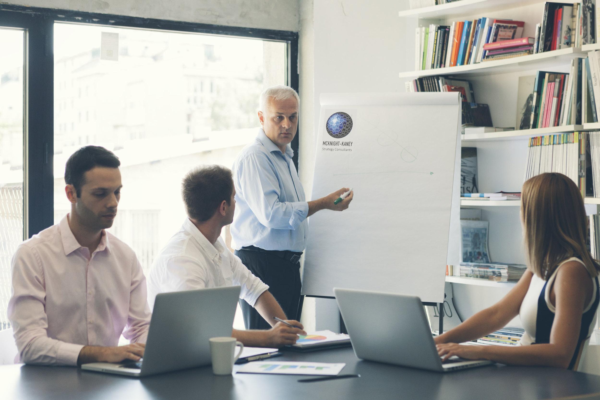 Businesspeople-having-meeting-in-office-000063255709_Large.jpg