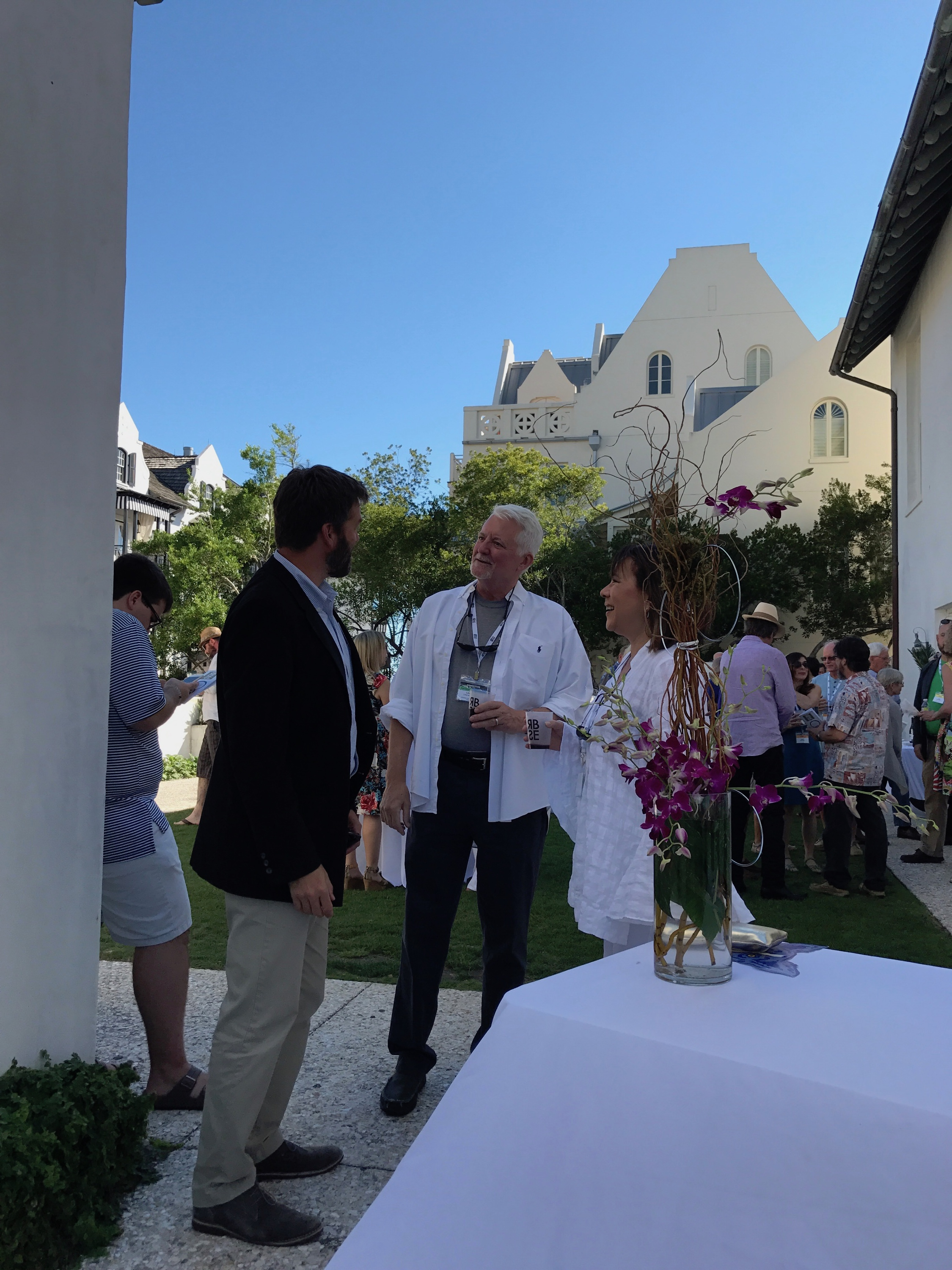 - From left, Rosemary Beach Town Manager David Bailey with Lawrence Pugh and Victoria Lee at the Opening Reception.